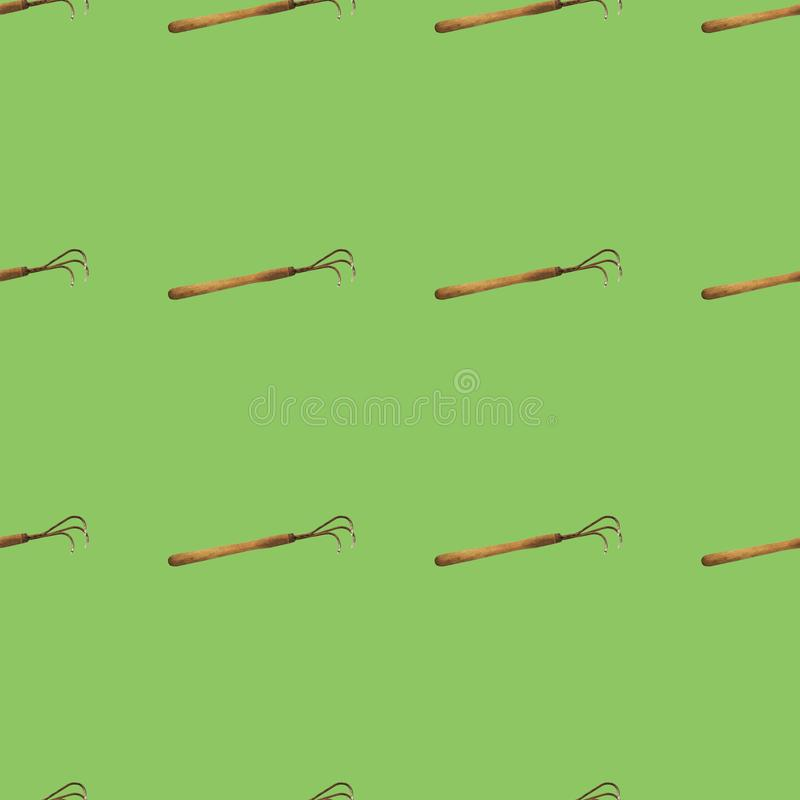 Seamless pattern of hoes on a green background stock images
