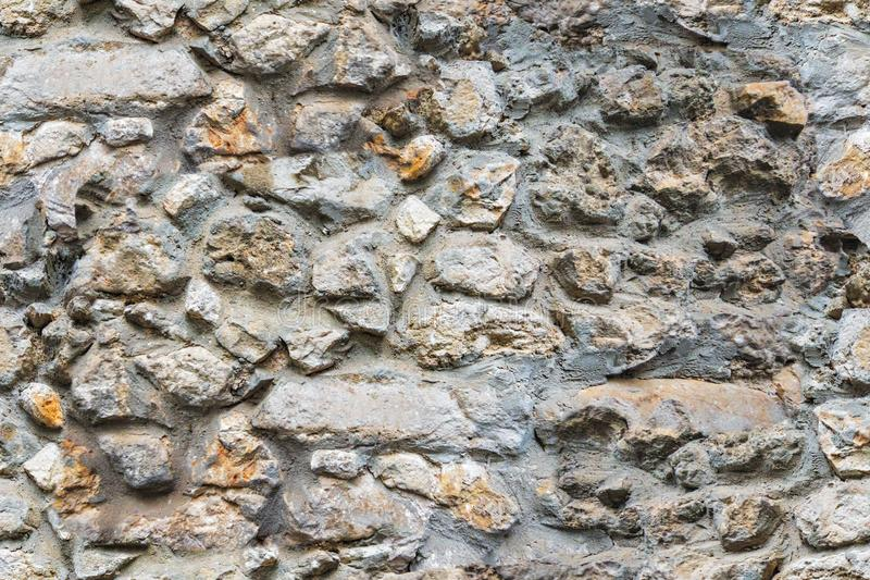 Seamless pattern old beige stone wall background texture close up royalty free stock image