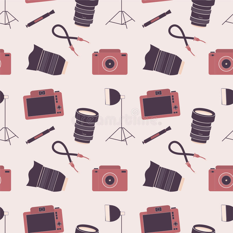 Seamless pattern with photo cameras, lenses and accessories royalty free stock photography