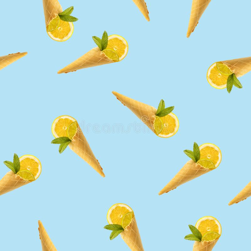 Seamless pattern with a picture of a horn for ice cream, lemon and mint royalty free stock photo