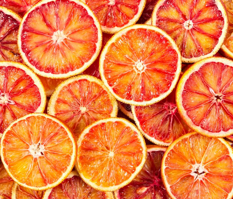 Seamless pattern with red Sicilian oranges. royalty free stock images