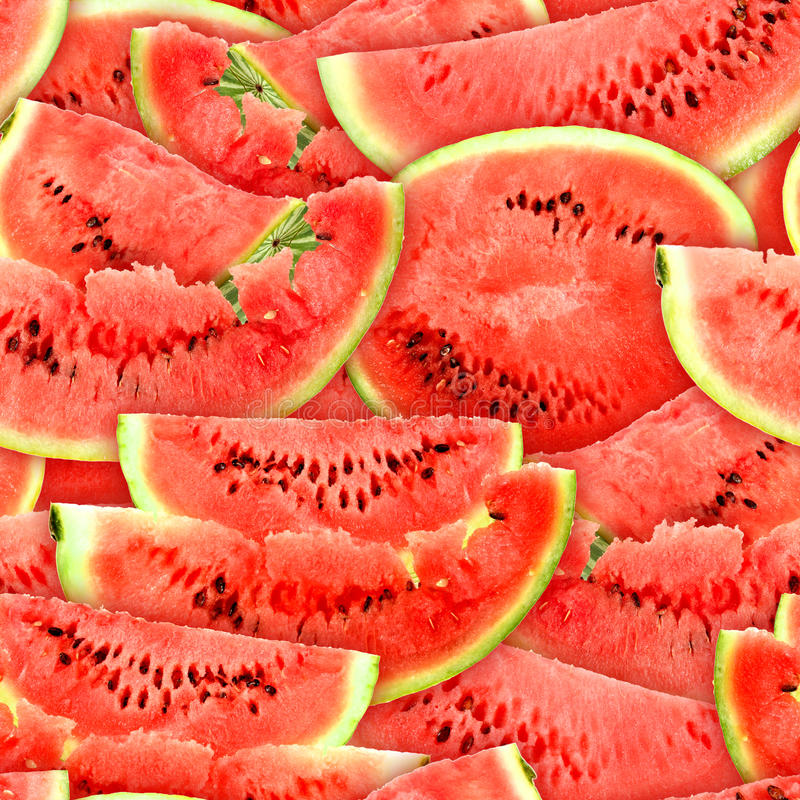 Seamless pattern of red watermelons slices. Abstract background with slices of fresh ripe red watermelons. Seamless pattern for your design. Close-up. Studio stock photography