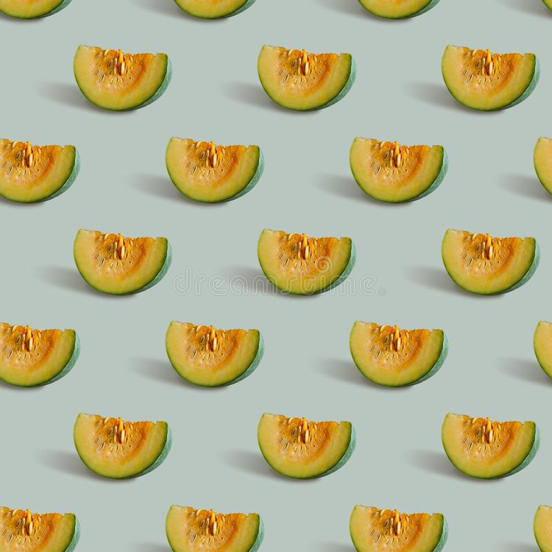 Seamless pattern with pumpkin slice on a gray-green background royalty free stock image