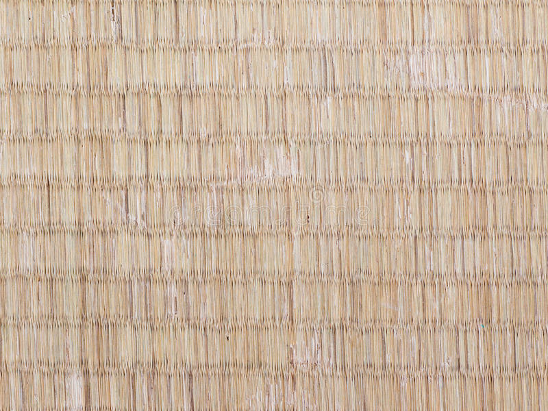 Seamless picture of the surface of worn out Japanese tatami mat. The seamless picture of the surface of Japanese tatami mat royalty free stock photos
