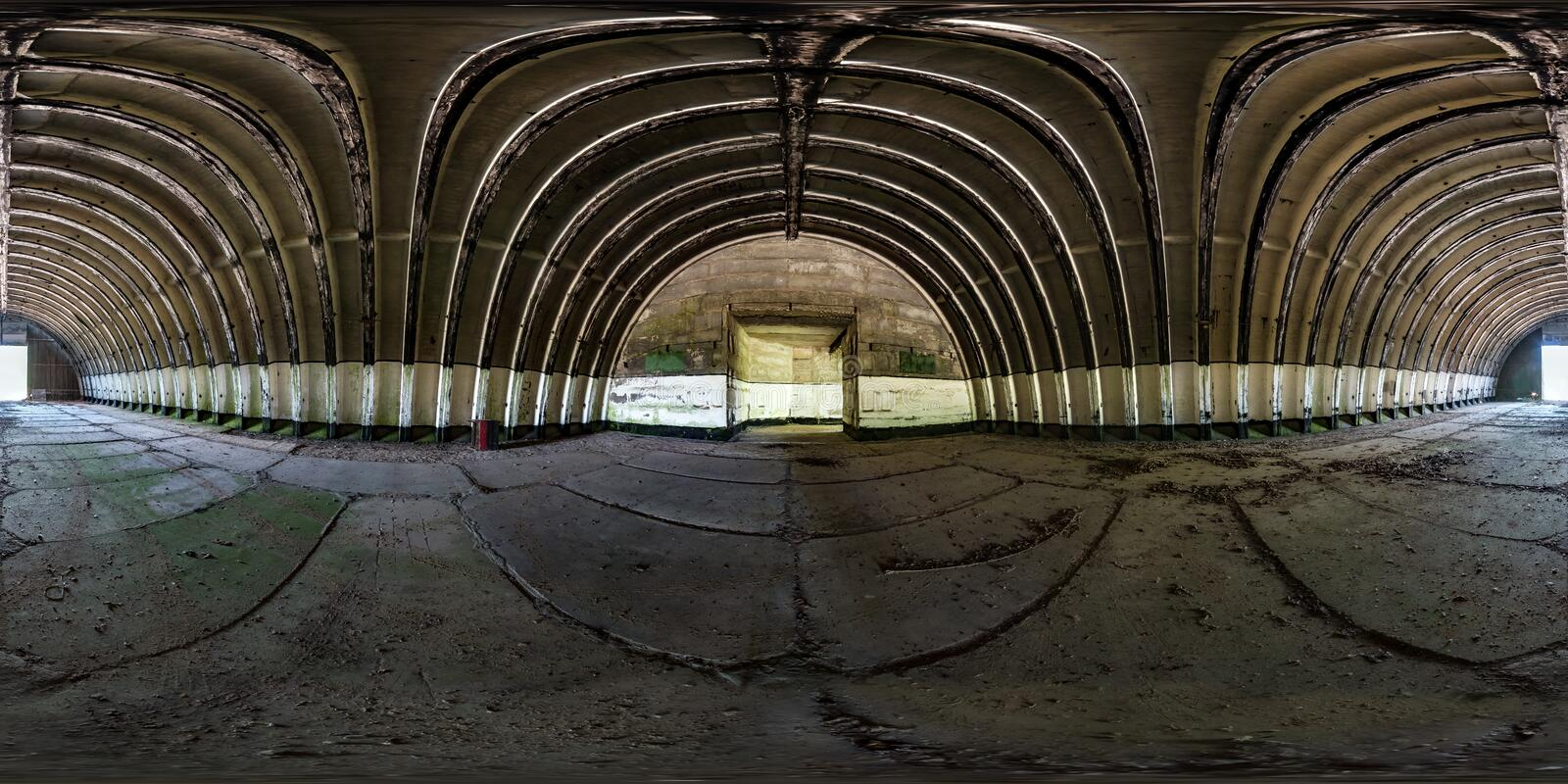 Seamless spherical hdri panorama 360 degrees angle view inside of empty old aircraft hangar in equirectangular projection with. Zenith and nadir, ready for AR royalty free stock images