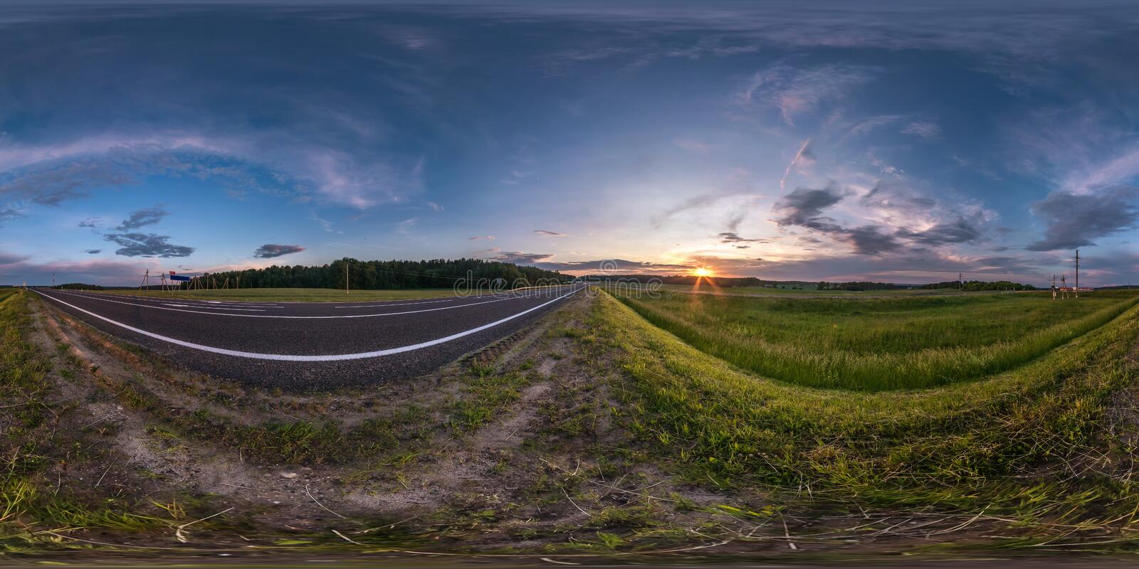 Seamless spherical hdri panorama 360 degrees angle view near asphalt road among fields in summer evening sunset with awesome. Clouds in equirectangular stock photos