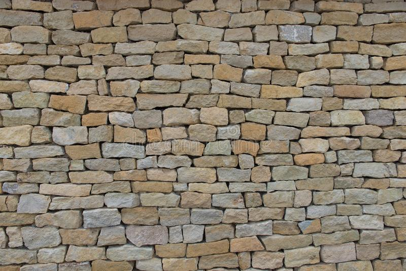 Seamless stone wall made with old bricks. royalty free stock photo