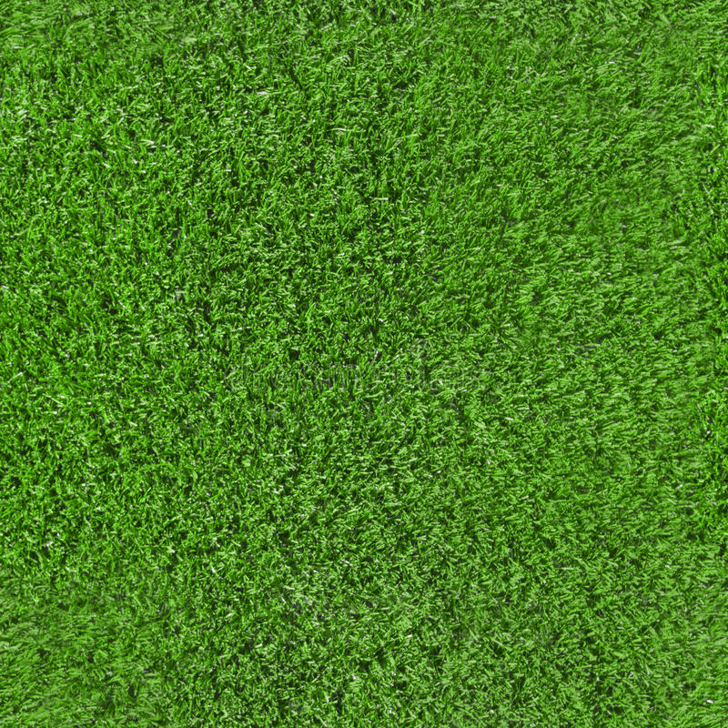 Seamless Synthetic Grass. Repeatable synthetic grass texture background with some highlights stock images