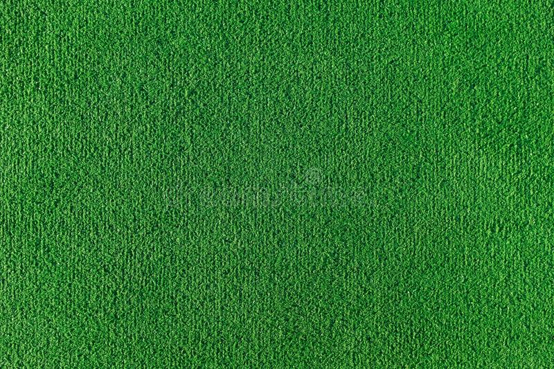 Seamless texture of artificial grass field. Green texture of a football, volleyball and basketball field stock image