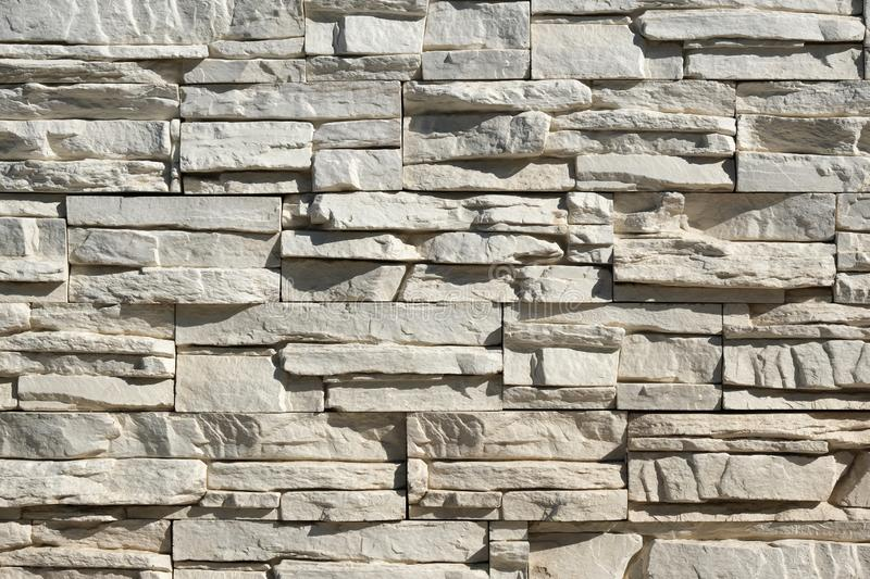 Seamless texture, background, stone lined with granite walls. sandstone. stone background wall. Facing Stone. stock image