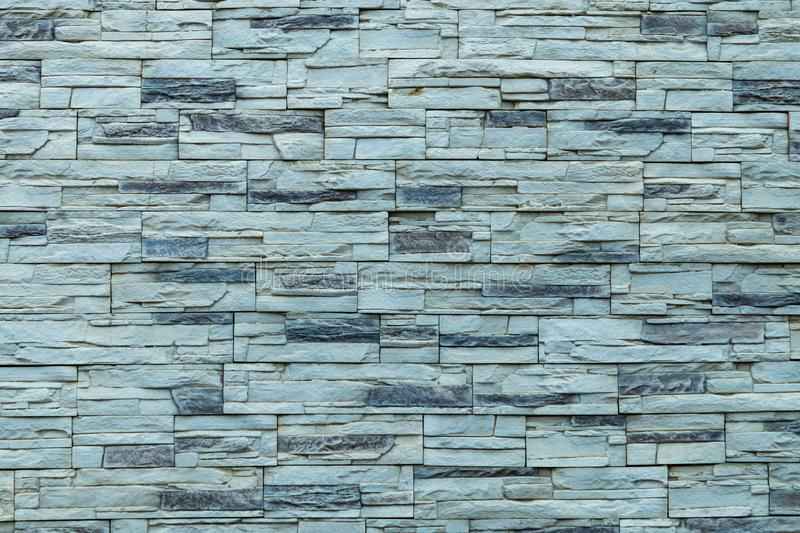 Seamless texture, background, stone lined with granite walls. sandstone. stone background wall. Facing Stone stock photo