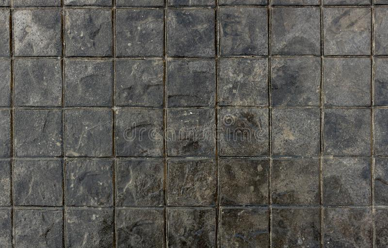 Seamless texture of black stones. Background texture of textured square floor ceramic tiles. royalty free stock image
