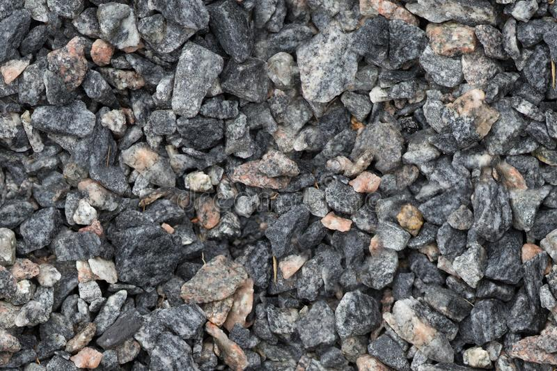 Seamless texture of close up granite breakstone gravel. Crushed stone background for design usage.  stock image