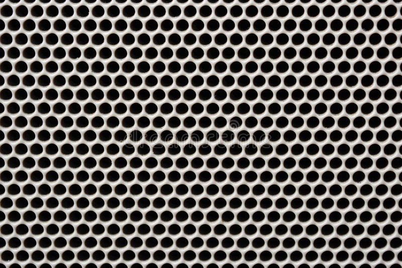 Seamless texture iron speaker grid background. stock images