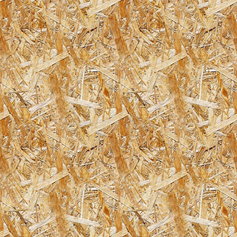 Seamless texture of pressed wood shavings. Chipboard sheet close up, the background is empty, seamless stock images