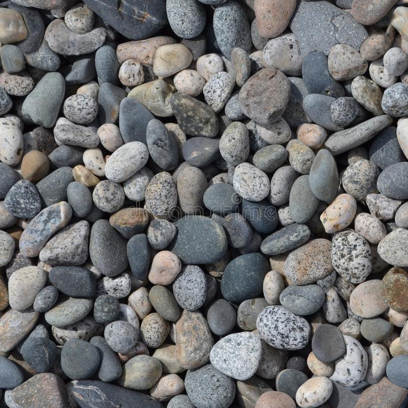 Seamless texture of stones of different sizes stock photography