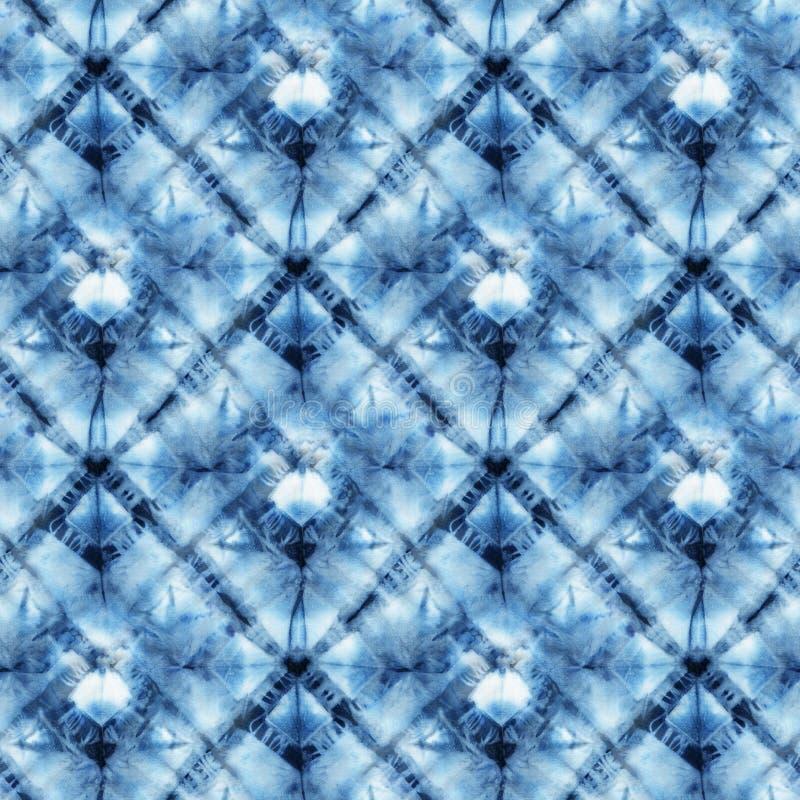 Seamless tie-dye pattern of indigo color. On white silk. Hand painting fabrics - nodular batik. Shibori dyeing royalty free illustration