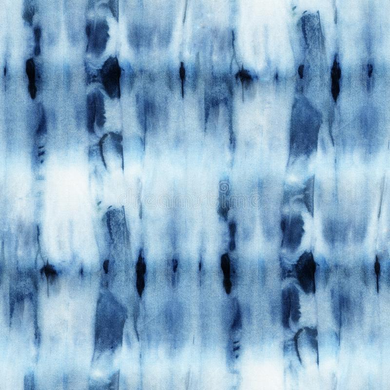Seamless tie-dye pattern of indigo color on white silk. Hand painting fabrics - nodular batik. Shibori dyeing royalty free illustration