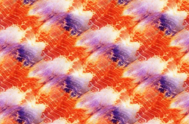 Tie Dye Background. Seamless tie-dye pattern of yellow and red  color on white silk. Hand painting fabrics - nodular batik. Shibori dyeing stock illustration