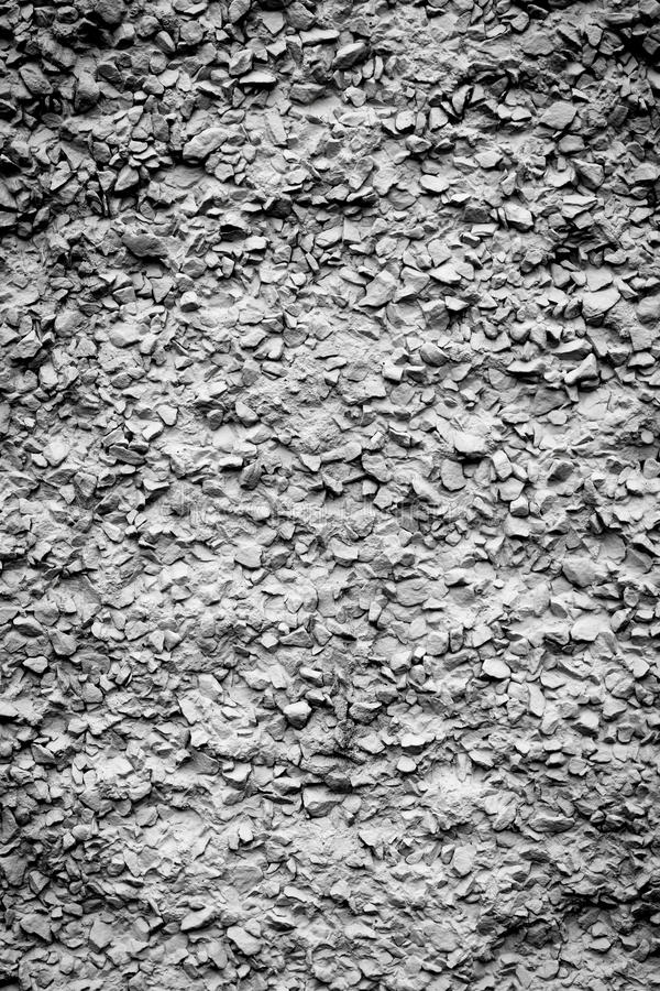 Seamless tile background of small stones. On sidewalk or wall stock photo