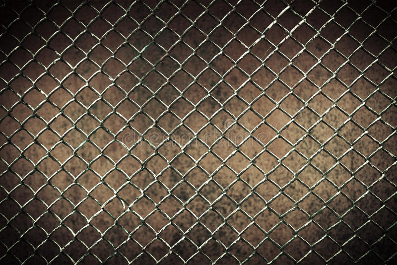 Seamless tileable chain link fence wall in background. Seamless tileable chain link fence wall stock photo
