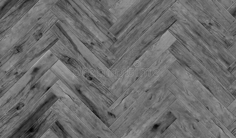 Seamless wood parquet texture herringbone pattern, glossiness. Seamless flooring texture in shevron pattern for indoor design rendering royalty free stock photo