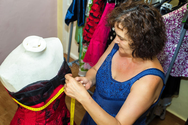 Seamstress doing arrangements. In a dress royalty free stock image