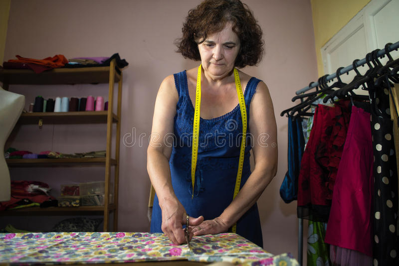 Seamstress doing arrangements. In a dress stock photography