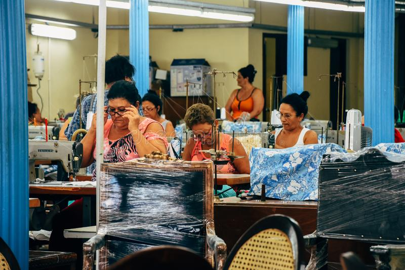 A seamstress factory in Havana, Cuba. Locals working in a seamstress factory in Havana, Cuba royalty free stock photography