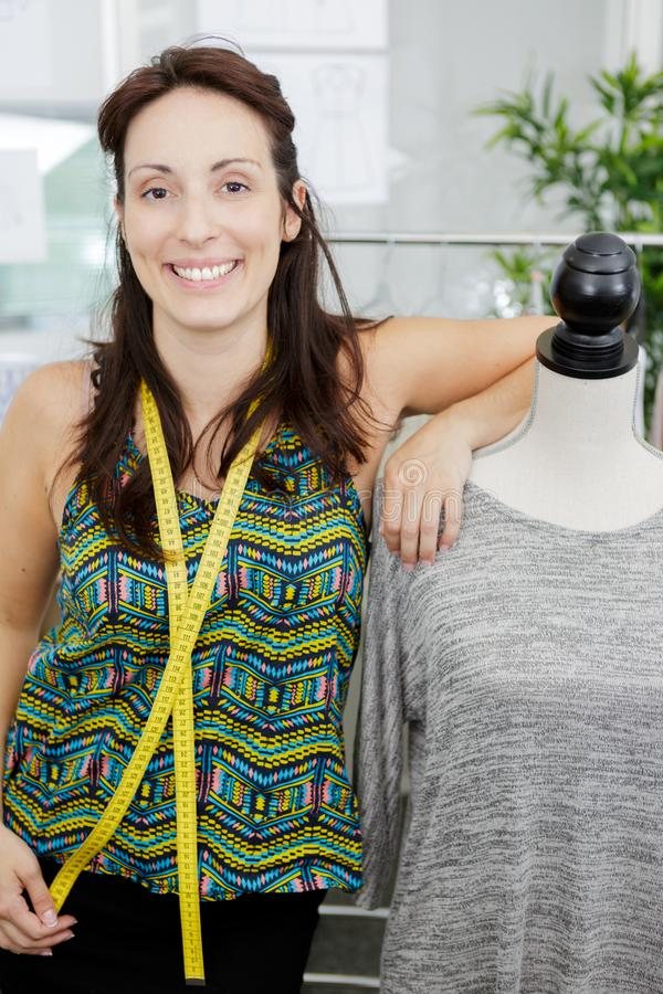 Seamstress posing confidently. A seamstress is posing confidently royalty free stock image
