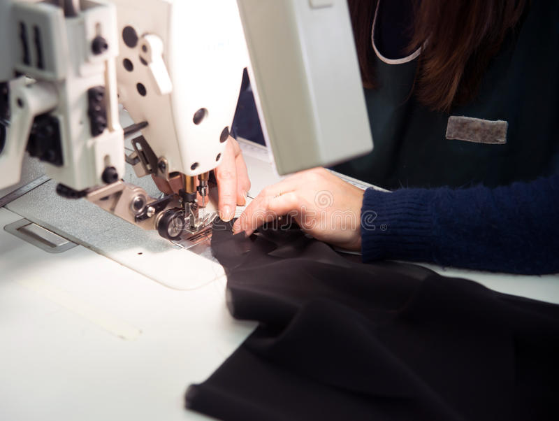 Seamstress. Sews garments luxury made in italy royalty free stock photography