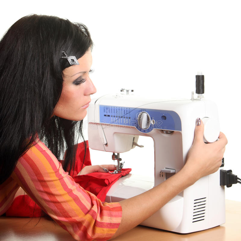Seamstress work on the sewing-machine stock images