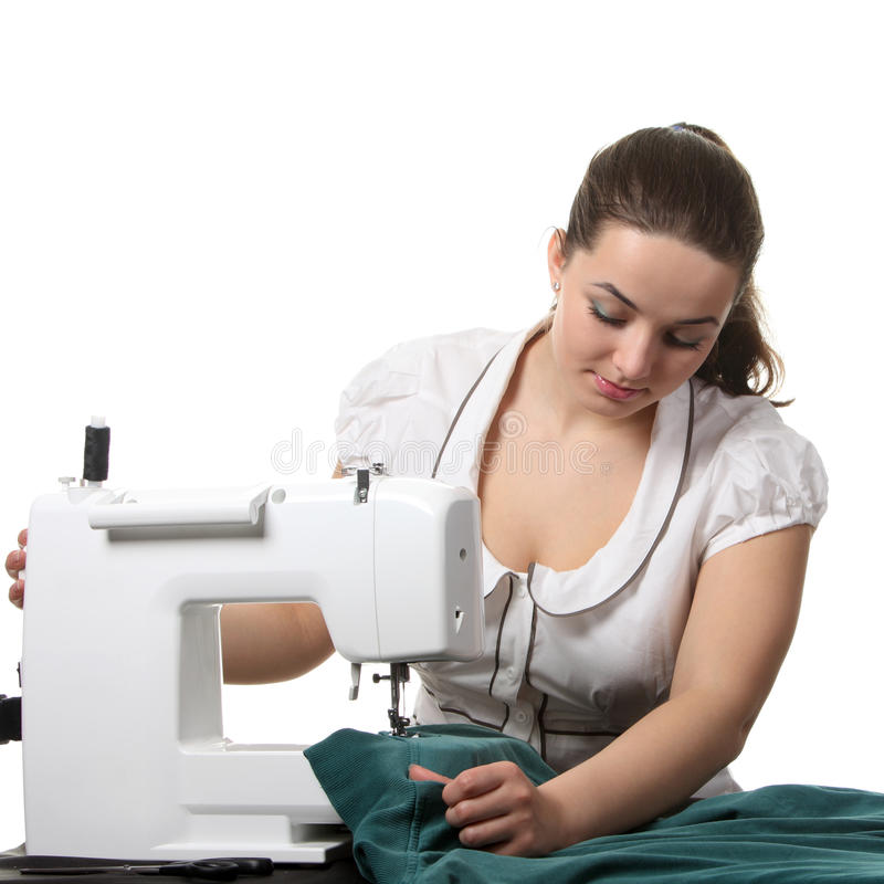 Seamstress work on the sewing-machine royalty free stock image