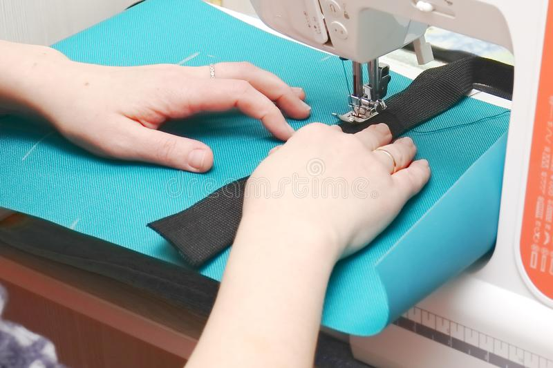 Seamstress at work on a sewing machine royalty free stock photo