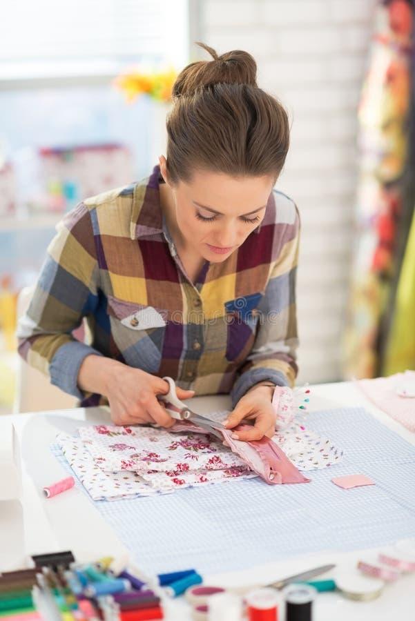 Seamstress working in studio stock photo