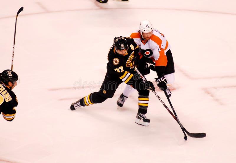 Sean Couturier Philadelphia Flyers. Philadelphia Flyers center Sean Coutourier gets his stick on Patrice Bergeron's (37) shot stock images