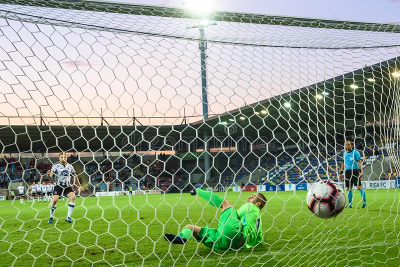 Sean Hoare L scores winning goal, during penalties. Roberts Ozols R, goalkeeper of RIGA FC on ground. RIGA, LATVIA. 17th of July, 2019. Sean Hoare L scores royalty free stock photos