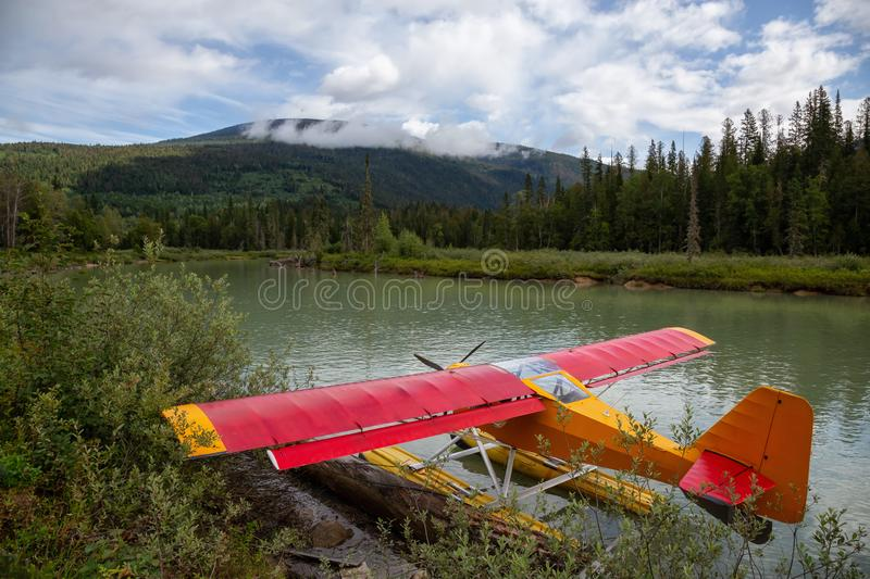 Seaplane docked at Mud Lake. With Mountains in the background. Taken in Blue River, North of Kamloops, British Columbia, Canada stock photos