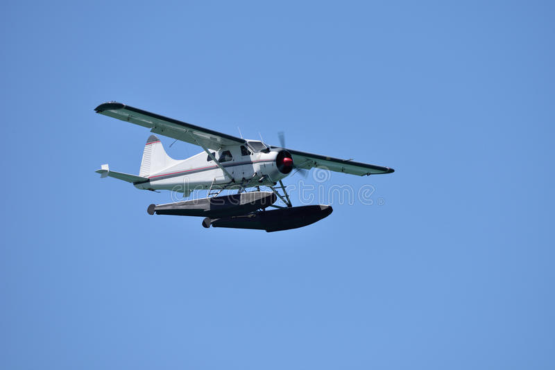 A seaplane in flight stock photos