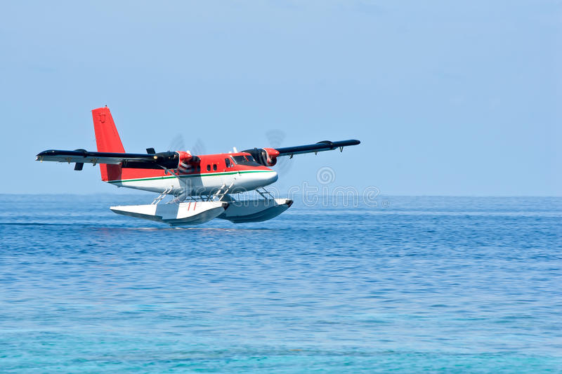 Seaplane landing,. The Indian Ocean, Maldives Islands royalty free stock photo