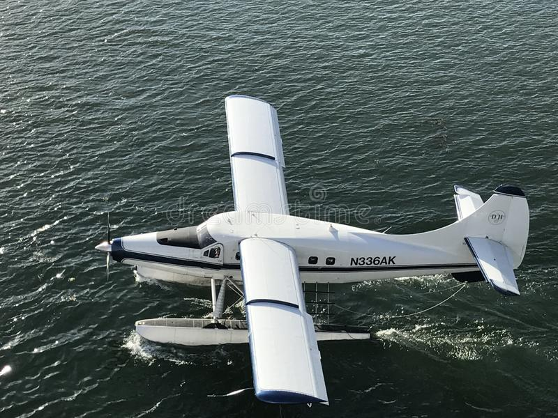 Seaplane lands in the water in Juneau, Alaska royalty free stock photos