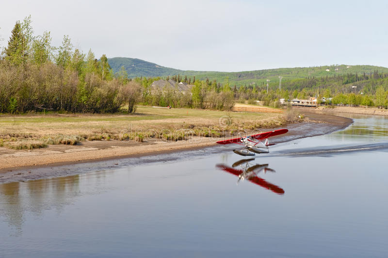 Seaplane taking off from river royalty free stock photo