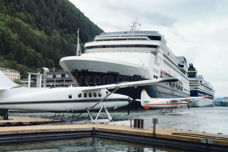 Seaplanes and cruise ships at the busy port of Juneau, Alaska royalty free stock image