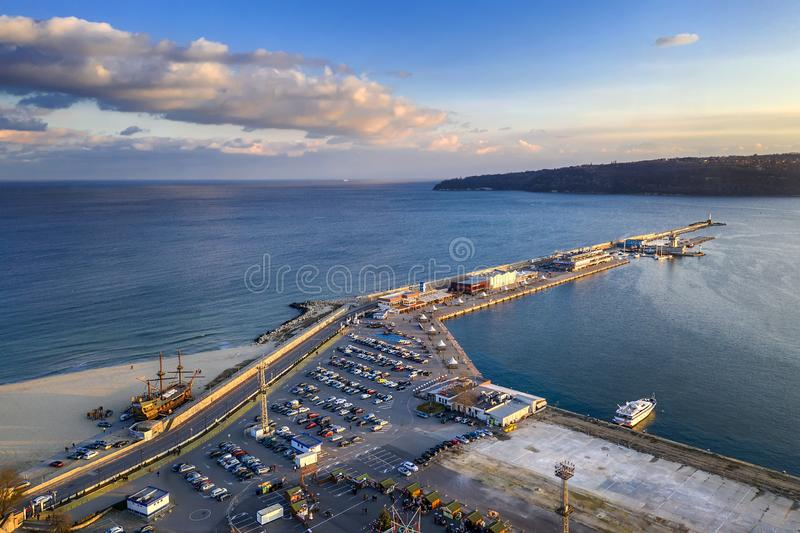 Seaport and breakwater at the stunning sunset. Black sea, Varna, Bulgaria. Aerial view from drone of seaport and breakwater at the stunning sunset. Black sea stock photo