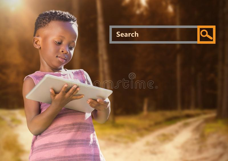 Search Bar with child on tablet in woods royalty free stock photography