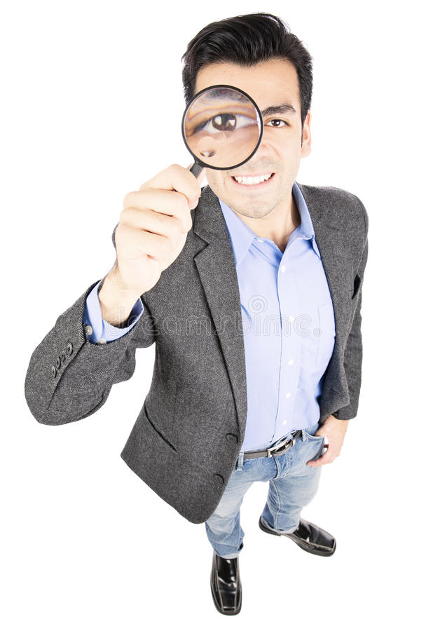 Search. Businessman holding magnify glass isolated on withe background stock photos