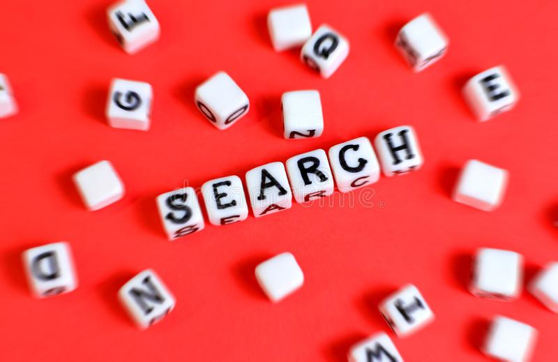 Search concept with cubes `Search` word and other defocused cubes. royalty free stock images