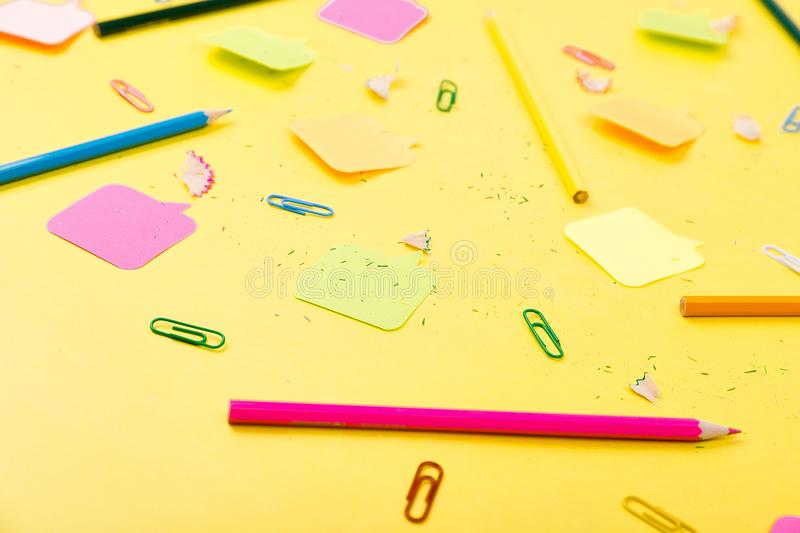 Search idea concept. Colorful pencils, stickers, clips on yellow background. School supplies. Exam, school student stock photo