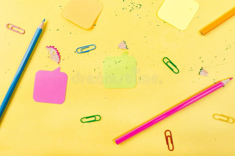 Search idea concept. Colorful pencils, stickers, clips on yellow background. School supplies. Exam, school student stock image