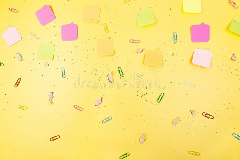 Search idea concept. Colorful stickers, clips on yellow background. School supplies. Exam, school student royalty free stock photo